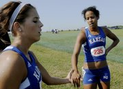 KU runners Amanda Miller, left, and Lauren Bonds, right, congratulate each other after completing the women's 5K run Saturday, August 30, 2008, at the Bob Timmons Invitational Cross Country meet at Rim Rock Farm. Bonds finished first for KU and Miller second.
