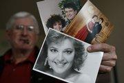 Jim Palin, Todd Palin's dad, displays Alaska Gov. Sarah Palin's beauty queen competition photo, a 1991 photo of Sarah and her husband Todd, center, and a prom photo of Sarah and Todd, back, Friday at his house in Wasilla, Alaska. Palin is Sen. John McCain's presidential running mate.
