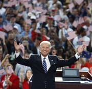 Democratic vice presidential nominee Sen. Joe Biden, D-Del., acknowledges the crowd Thursday at the Democratic National Convention in Denver.