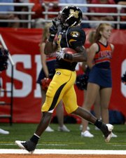 Missouri wide receiver Jeremy Maclin quiets the crowd after returning a kickoff 99 yards for a touchdown. Missouri beat Illinois, 52-42, on Saturday night in St. Louis.