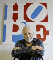 Artist Robert Indiana, who in the 1960s created the pop icon LOVE, now has created a similar image with HOPE, pictured in background Thursday at Indiana's studio in Vinalhaven, Maine. Proceeds from the artwork will go to Barack Obama's presidential campaign.