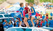 Young Jayhawk fans dance on top of a car before Kansas University's first football game of the season Saturday in Memorial Stadium. Cars were filling the stadium's parking lots Saturday afternoon before KU played against Florida International on Saturday night. The Jayhawks won 40-10 in front of a record crowd of 52,112 fans.