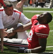 Ohio State running back Chris Wells reacts as trainers check on his injury during the third quarter. Despite the injury, Ohio State ripped Youngstown State, 43-0, on Saturday in Columbus, Ohio.