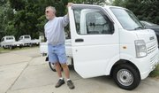 Scott Bartlett, owner of Scott's Shop Inc., Holton, has sold several used Japanese mini-trucks to customers and has several more on his lot. The fuel-efficient utility vehicles are catching on in the U.S. and becoming popular replacements for regular trucks among farmers and people needing multi-functional vehicles for less money.