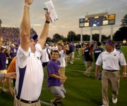 East Carolina coach Skip Holtz turns to the crowd and celebrates his team's 24-3 upset victory against West Virginia. East Carolina defeated No. 8 West Virginia, 24-3, on Saturday in Greenville, N.C.