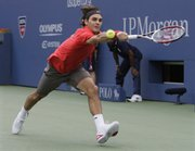 Roger Federer returns a shot to Novak Djokovic during their U.S. Open semifinal match. Federer won, 6-3, 5-7, 7-5, 6-2, on Saturday in New York.