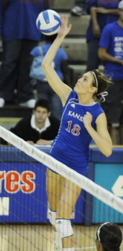 Kansas University's Savannah Noyes spikes against Central Florida. The Jayhawks beat UCF in four sets Saturday at Horejsi Center.