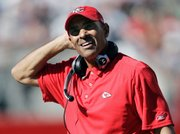 Kansas City Chiefs coach Herm Edwards walks on the sideline in the fourth quarter Sunday in Foxborough, Mass. Even though Damon Huard will start at quarterback Sunday, Edwards has said Tyler Thigpen also will see time.