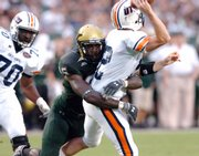 USF defensive end George Selvie hits UT Martin quarterback Cade Thompson in this Aug. 30 file photo in Tampa, Fla. Selvie, who led the country in tackles for loss last year, will look to give KU fits on Friday.