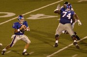 Jeff Spikes (74) blocks for KU quarterback Todd Reesing in the Jayhawks' Aug. 30 home victory against Florida International. Spikes will have his hands full on Friday against South Florida defensive end George Selvie.