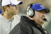 Kansas head coach Mark Mangino glances up at the scoreboard during the third quarter Friday, Sept. 12, 2008 at Raymond James Stadium in Tampa.