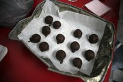 freshly chilled red wine truffles are among Jean Younger's confections. She experiments with unusual ingredients, including ancho and cumin.