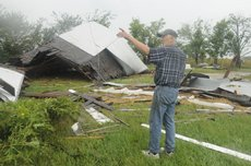 Mark Gabriel surveys his tornado-ravaged rental property located at 945 E. 2300 Road on Friday south of Eudora.  Gabriel says that he thinks the rental and barn are a total loss and valued at about $70,000.