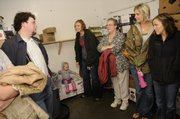 People take shelter in a cold storage locker in the back of the C & S Market in Eudora on Sept. 12, 2008 as tornado sirens sound in the county. From left are C & S employee Lucas Wright, Eudora; 16-month-old Cosette Kemnitz and her mother Olivia Kemnitz, Mission; Renee Brown, Eudora; and Jenna Johnston and Kristen Scott, both of Overland Park. Several travelers passing through Eudora on Kansas Highway 10 took shelter at the grocery, just off K-10 as a major storm passed through the area.