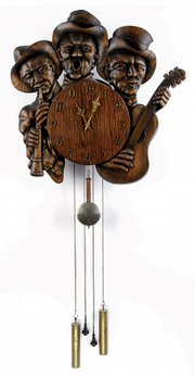 Wooden musicians hold an oak clock with brass numerals and hands. The clock was made about 1900 and belonged to the family that owned the Old Boston Distillery. It sold for $3,680 at a James Julia auction in Fairfield, Maine.