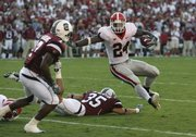 Georgia's Knowshon Moreno leaps past South Carolina's Mike Newton (35) on his way to a 4-yard, go-ahead touchdown in the fourth quarter of Georgia's 14-7 victory over South Carolina on Saturday in Columbia, S.C.