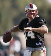 In this July 29 file photo, San Francisco quarterback J.T. O'Sullivan passes during NFL training camp in Santa Clara, Calif. With nine stints on eight NFL teams in the last seven years, the quarterback has never stayed in one place for long since leaving college.