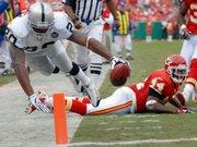 Oakland's Darren McFadden dives into the end zone for a touchdown past Kansas City's Jarrad Page.