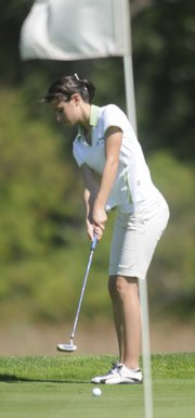 Free State High junior Grace Brahler putts at the Free State Invitational Tuesday at Eagle Bend Golf Course.