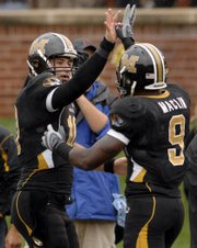 Missouri quarterback Chase Daniel, left, congratulates Jeremy Maclin after Maclin&#39;s 80-yard touchdown reception against Nevada on Saturday. The Tigers lead the country with a scoring average of 57.67 points per game.