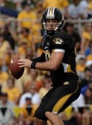 Missouri quarterback Chase Daniel prepares to throw against Buffalo on Saturday in Columbia, Mo. Daniel set a Big 12 record for consecutive completions in a game last week with 20.
