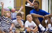 Kansas basketball player Markieff Morris looks over as Hillcrest kindergartners Rachel Parks, left, Diego Flores and Caden Nichols think about what foods are nutritious Wednesday, Sept. 24, 2008 at Hillcrest School.