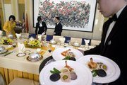 Chinese waiters and waitresses prepare a lunch for a high-level official event at the Diaoyutai State Guesthouse in Beijing in this Dec. 11, 2007, file photo. The nation's political elite has access to gourmet, all-organic delicacies while the rest of the populace face a food supply fraught with sometimes harmful items - cancer-causing fish, pesticide-laden vegetables and chemical-tainted milk products.