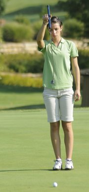 Free State's Grace Brahler lines up a putt during the Lawrence High Invitational.