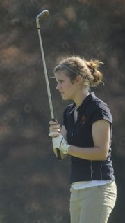 Lawrence High's Kathryn Lunte watches her shot on hole No. 9 during the Lawrence High Invitational.