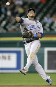 Kansas City Royals second baseman Mike Aviles throws to first on a ground ball hit by Detroit's Miguel Cabrera. The Royals beat the Tigers, 10-4, on Wednesday in Detroit to escape last place.