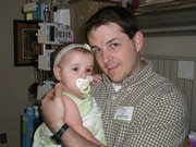 KU graduate student Brandon Gwilliam holds his daughter McKensie at Children's Mercy Hospital in Kansas City, shortly after she was diagnosed with leukemia.