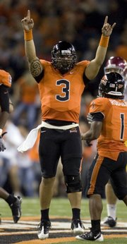 Oregon State quarterback Lyle Moevao celebrates a 27-21 victory over Southern Cal. The Beavers beat the top-ranked Trojans on Thursday in Corvallis, Ore.