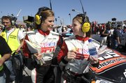 Pit-road reporters Jamie Little, left, and Shannon Spake take a break on the scene in Daytona Beach, Fla. The women are in Kansas City, Kan., for this weekend's NASCAR races at Kansas Speedway.