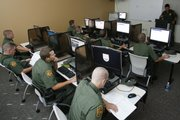 U.S. Border Patrol interns work at computer terminals during a training class this month at the Border Patrol sector headquarters in Imperial, Calif. Towns and small cities along the 1,952-mile border with Mexico have benefited economically from the Border Patrol's growth over the last decade.