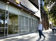 Arun Chatterjee waits for a branch of Washington Mutual to open Friday in downtown Sacramento, Calif. Washington Mutual, one of the nation's largest banks, was seized by the Federal Insurance Corp., Thursday, and then sold to JPMorgan Chase & Co.