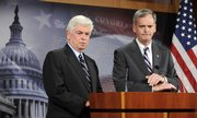 Senate Banking Committee Chairman Chris Dodd, D-Conn., left, and Sen. Judd Gregg, R-N.H., right, hold a news conference on the failed vote in the House of Representatives on the financial bailout package on Capitol Hill in Washington on Monday.