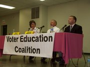 Douglas County Commission candidates Nancy Thellman, left, listens to an answer from her opponent David L. Brown during Thursday night's forum at the Douglas County Fairgrounds. 6News Director Cody Howard moderated the forum sponsored by the Voter Education Coalition.