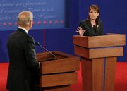 Republican vice presidential candidate, Alaska Gov. Sarah Palin, right, speaks during the vice presidential debate with Democratic vice presidential candidate, Sen. Joe Biden, D-Del., at Washington University in St. Louis, Mo., Thursday, Oct. 2, 2008.