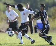 Lawrence High forward Eddie Okene gets past a Topeka High defender during the Lions' 2-0 victory against the Trojans on Thursday at Youth Sports, Inc. Okene gave LHS a 1-0 lead in the first half with his fourth goal of the season. In the second half, senior Dar Fornelli scored on a header off of a corner kick from Will Burg. The victory snapped a six-game losing skid and improved LHS to 3-6 on the season. Next up, the Lions face Olathe Northwest on Tuesday at YSI.