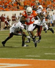 Oklahoma State running back Kendall Hunter, center, runs for a touchdown during the first half against Troy. Hunter is the Big 12's leading rusher at this stage of the season.