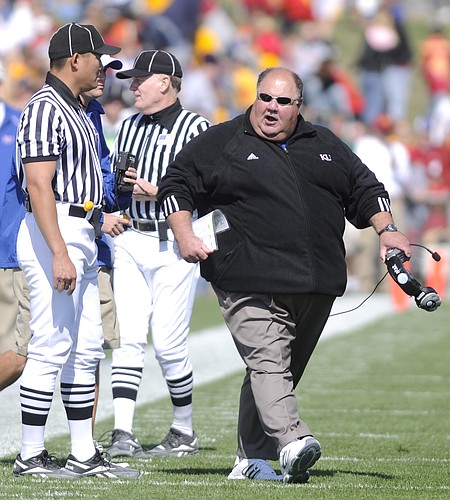 Kansas head coach Mark Mangino has words for an official during the second quarter Saturday, Oct. 4, 2008 at Jack Trice Stadium in Ames.
