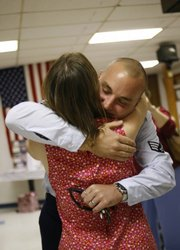 Tammy Ziesenis, left, welcomes her son, Sid Pastor III, home from his third tour of duty in Iraq on Saturday, Oct. 4, 2008 during a celebration at the VFW in Lawrence.