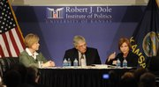 U.S. rep. Nancy Boyda, D-Kan., left, and State Treasurer Lynn Jenkins went head to head before a full house Monday at the Dole Institute of Politics. KU law professor Mike Kautsch moderated the debate.