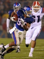 Kansas University wide receiver Dezmon Briscoe racks up yards after the catch in this file photo from the Jayhawks' game against Louisiana Tech. In that Sept. 6 game, Briscoe had seven catches for 147 yards.