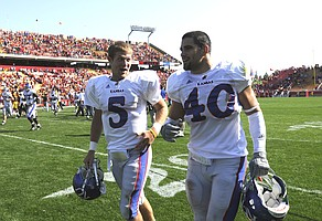 Kansas quarterback Todd Reesing, left, and linebacker Mike Rivera make their way from the field following the Jayhawks' 35-33 comeback victory against Iowa State on Saturday at Jack Trice Stadium in Ames, Iowa. Rivera had a season-high seven tackles.