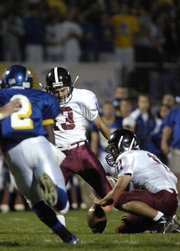 LHS senior Spencer Scott connects for a field goal Friday, Oct. 10, 2008 during the Lions' game against Olathe South High School at ODAC.