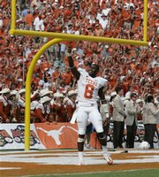 Texas cornerback Chykie Brown (8) celebrates the Longhorns' 45-35 win over No. 1 Oklahoma in an NCAA college football game, Saturday, Oct. 11, 2008, in Dallas.