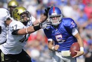 Kansas' Todd Reesing runs down field against Colorado's Shaun Mohler on Saturday, Oct. 11, 2008 at Memorial Stadium.