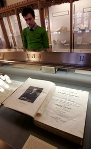 Yale University employee Geoffrey Little looks at an early edition of Noah Webster&#39;s Dictionary at the Sterling Memorial Library at Yale University in New Haven, Conn. Webster&#39;s 250th birthday will be observed this week.