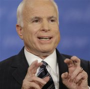 Republican presidential candidate Sen. John McCain, R-Ariz., gestures as he responds to Sen. Barack Obama's stand on abortion during a presidential debate at Hofstra University in Hempstead, N.Y., Wednesday, Oct. 15, 2008.